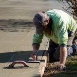 Finishing edges on a concrete driveway in Foster, South Gippsland