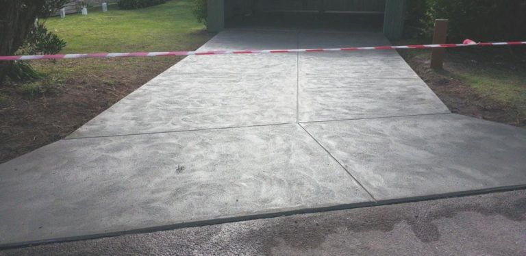 Plain concrete driveway in Sandy Point, South Gippsland